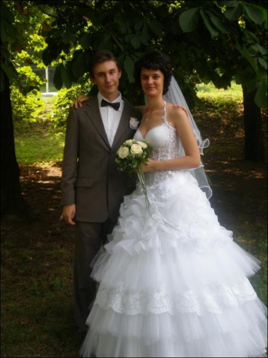 жена Карякина